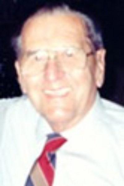 photo of previous HRCCU board president Windsor Cote, an elderly man wearing a white button down shirt