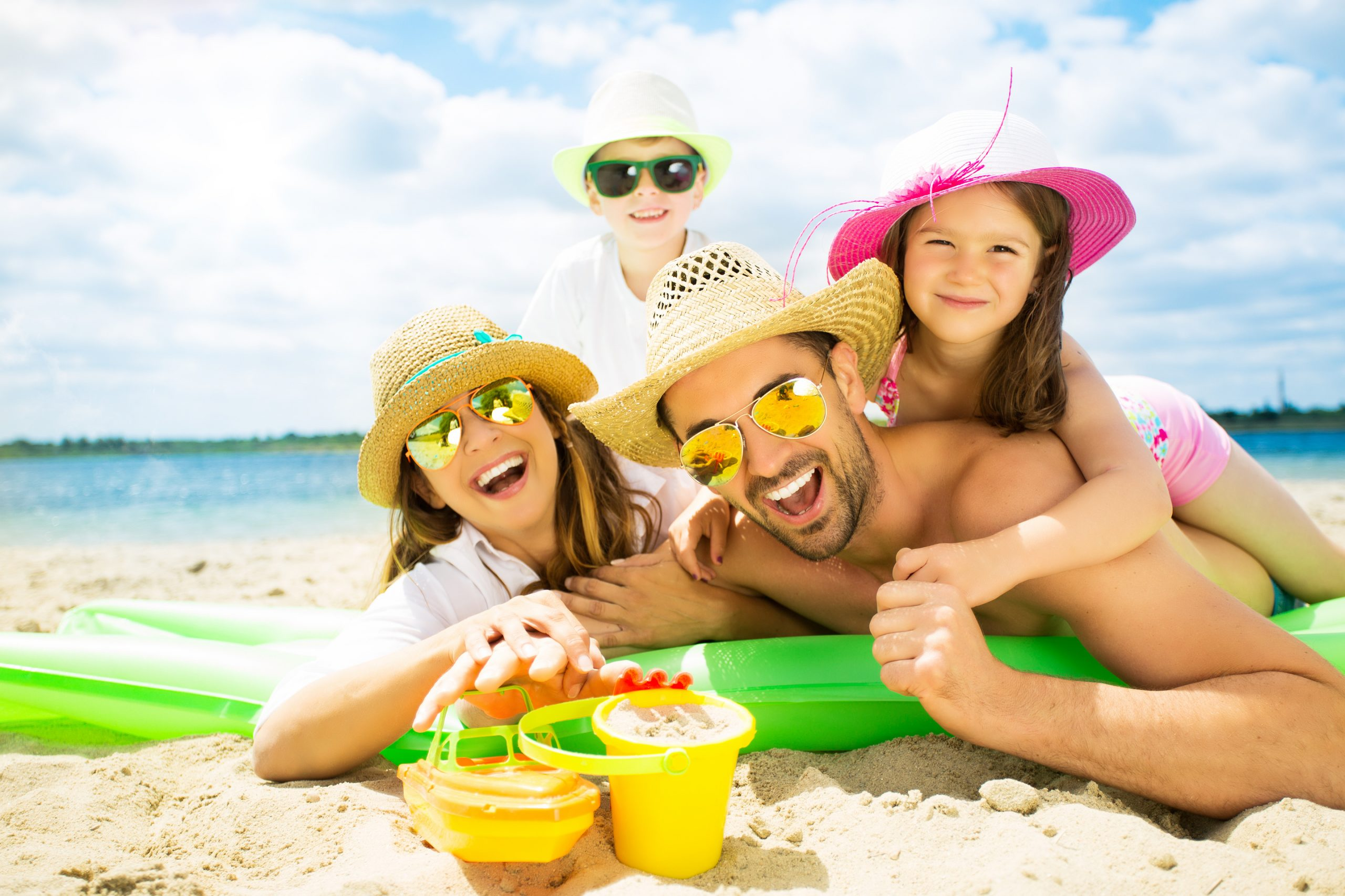 Picture of family at the beach having fun during the summer time.